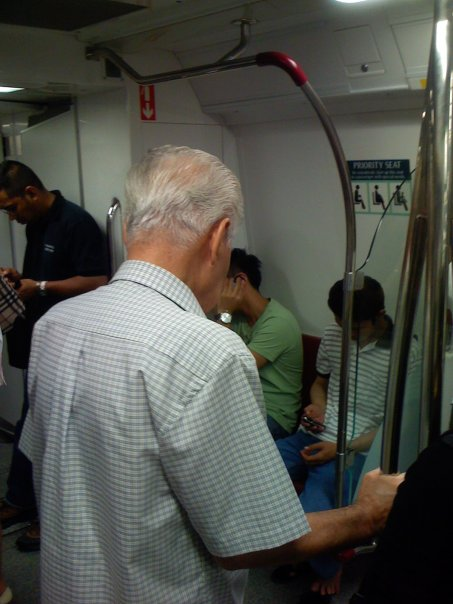 old-man-standing in mrt